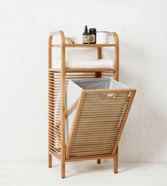 Hamper It's pretty, eco-friendly, and functional. Made from bamboo and recycled plastic bottles, this hamper comes with shelves to hold othe...