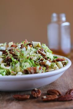 Brussel Sprout Chopped Salad with bacon, pears, candied pecans, blue cheese, and maple-bacon vinaigrette (Blue Cheese Vinaigrette)