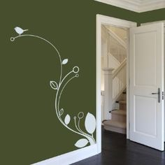 this is fun and easy.  use vinyl to decorate and give your walls some life!!!! this wil lighten up your house and its easy to remove and replace and wil leave your walls undamaged.