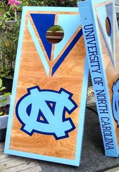 In desperate need of a different team, but like the look overall.  Custom Stained Cornhole Boards by handmadesbyKaren on Etsy, $175.00