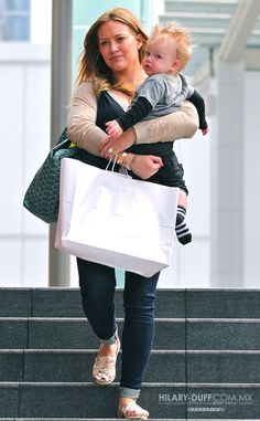 Hillary Duff uses her Goyard(s) as Baby Luca's diaper bag – she also has the St. Louis in yellow, green and blue.