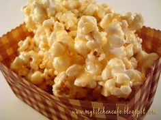 The Best Carmel Corn -INGREDIENTS:  1 cup butter (2 sticks)  2 cups sugar  1 cup powdered vanilla whey protein (found in any health food aisle from Wal-mart to your everyday grocery store)  1/2 cup light corn syrup  1/3 cup water  1 teaspoon vanilla  1/2 teaspoon salt  3/4 teaspoon baking soda  2 large bowls of popped corn
