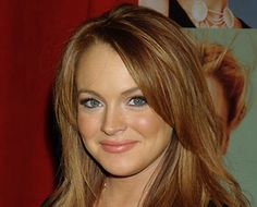 Lindsay Lohan looks vivacious and delighted when she embraces her natural coloring.