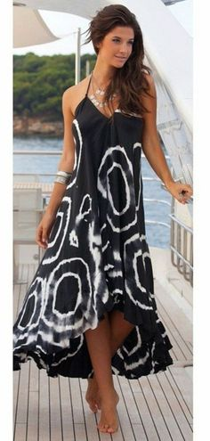 """Don't hold back your love for this gorgeous Gentle Winds maxi! It features a beautiful black and white pattern with an open halter tie back neck and irregular hem. Sizing: S-XL - Bust: S-34"""", M-36"""", L"""