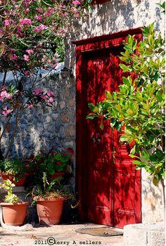 red door to the garden