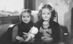 Two Jewish girls pose with their dolls (Netherlands, 1942)