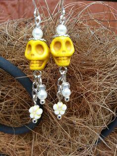 Yellow skull daisy earrings.