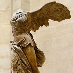 The celebrated Winged Nike (Victory) of Samothrace that stood at the  island's Temple complex dedicated to the Great Gods on a rostral pedestal  representing ...