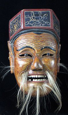 Maonan Nuo Mask. Huanjiang, Guangxi, SW China. Painted wood & hair. The God of Earth is one of the most popular deities throughout China, and is an important character in the Maonan version of the Nuo Opera. Made by Maonans are farmers who grow millet and buckwheat and have a population of some 107,000, most of whom live in Guangxi Autonomous Region. In 1964, there were 183 ethnic groups registered, among which only 54 are recognized. Assimilation into modern society is being encouraged