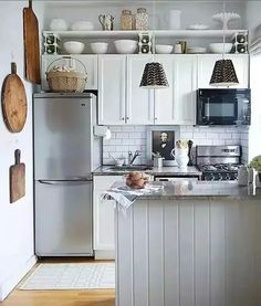 More than 80 Quick Rental Fixes for the Kitchen | Apartment Therapy  See the way they built that shelf above the cabinets—no wall installation necessary!