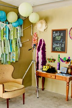 DIY Photobooth (a 'set up area' w a cool chair as opposed to a backdrop)