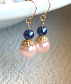 Set of three 3 Navy and blush earrings Navy and blush bridesmaid earrings Gold Bridesmaid Earrings Pink and navy wedding gift Navy and gold Wedding This listing is for three pairs of earrings. The earrings are made from Czech glass pearl beads in blush (10mm) and navy blue (6mm) color, gold plated details. The earrings are about 4cm/1.57 long. All the jewelry comes packed as gifts in boxes. Matching necklace You can find here: https://www.etsy.com/listing/51323183...