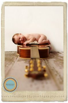 Baby on a guitar. Great picture idea for a parent who's a musician...