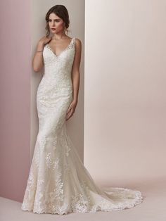 Delicate lace motifs cascade over tulle in this soft fit-and-flare wedding dress. Sheer straps glide from V-neckline to illusion scoop back, all accented in lace motifs. You'll love the Elora wedding dress by Rebecca Ingram. Wedding Dresses Photos, Black Wedding Dresses, Princess Wedding Dresses, Tulle Wedding, Boho Wedding Dress, Designer Wedding Dresses, Bridal Dresses, Wedding Gowns, Mermaid Wedding