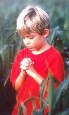 BOY in CORNFIELD ....Photo by Steve ..... Saved by the Grace of God