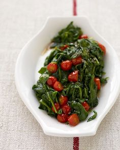 Wilted Spinach and Cherry Tomatoes - Martha Stewart Recipes~ I put oil and chopped garlic in the pan first then some mushrooms. Once they were slightly cooked I added some spinach and a little bit of white wine vingar. At about the last 2 mins of cooking i added chopped tomatoes. Cook on med Low heat, Adam loved it!!