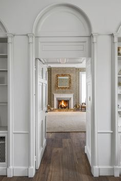 Ground Floor Hallway With Cool White Walls And Warm Wooden Floors Leading  To Living Room #