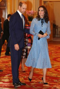 Tender moment: Prince William affectionately placed a hand on his wife's back as they ente...