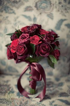 A bouquet of red roses is a classic that never fails. But make it different...I love this mix of reds with a velvety vintage feel.