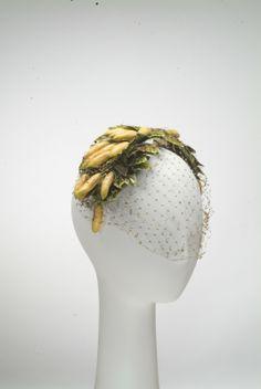 hat (banana)  Artist  Bes-Ben | American | 1898-1988  Creation date  1940-1949  Materials  coated paper, plastic, silk trim, silk net