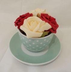 artificial tea cup and saucer arrangement