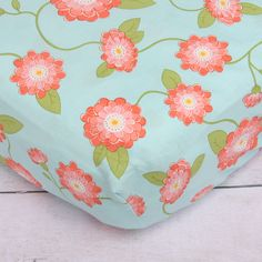 Coral Floral Crib Sheet - love this bright, sweet, whimsical design in a baby girl nursery!