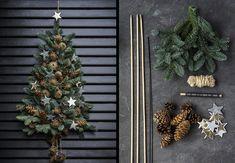 Byd gæster og julen velkommen med et fint pyntet grantræ på hoveddøren