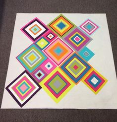 This fun happy quilt was quilted by JoAnn Gemmill using Hobbs Tuscany Polyester