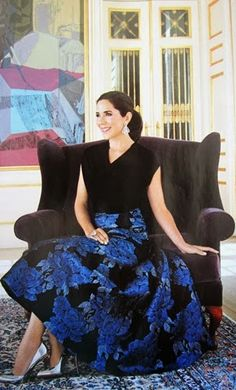 A great photo of Princess Mary. Love the dress.