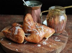 Herb Beignets: savory donuts filled with herbs, fried in bacon fat and served with garlic butter and parmesan