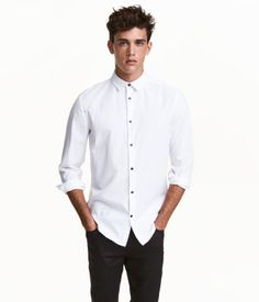 White. Shirt in woven fabric with a turn-down collar, smooth button placket, and cuffs with buttons. Slim fit.