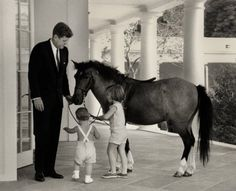President Kennedy, Caroline, and John, Jr. with pony