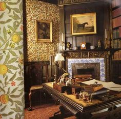 Library at Speke Hall, Merseyside, with 'Pomegranate' pattern wallpaper by William Morris. 'Pomegranate', first printed in 1864, is one of several original Morris papers surviving at Speke Hall from the late 1860s. #William_Morris #Morris_and_Co