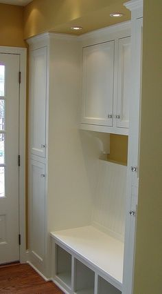 Very attractive mudroom bench with plenty of cabinet storage for coats & shoes, would love to rip out the closets in the entry way and do this. So much useable storage and not just a plain closet