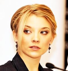 Natalie Dormer - it almost looks like her mouth is a little crooked, which is probably why she smiles the way she does. As someone with a cleft lip, it's comforting to know she can look as cute as she does doing it, even if she doesn't have a cleft.