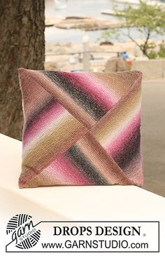 """Ravelry: 124-15 Cushion cover in garter st with half Domino squares in """"Delight"""" pattern by DROPS design"""