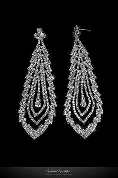 Lorna Cascade Long Dangle Chandelier Crystal Earrings. Description: This Cascade Statement Chandelier Earrings is created with best quality sparkling Crystal and Rhodium Finish. A georgeous piece with