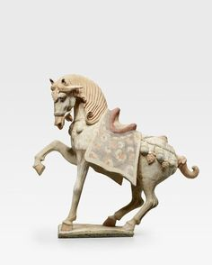 A painted pottery figure of a prancing horse, Tang dynasty (618–907)