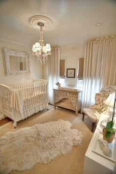 A very elegant and romantic feeling nursery. From the chandelier to the mirror above the crib and the mirrored dresser and chair in the corner, everything has such an elegant feel to it.