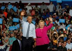 President Barack Obama stands with Democratic U.S. presidential candidate Hillary Clinton during a Clinton campaign event in Charlotte, North Carolina, U.S., July 5, 2016.