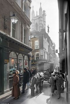 A view of Bow Lane, off Cheapside in the City of London, looking south to the crossing with Watling Street and St. Mary Aldermary in the mid...
