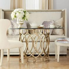 http://www.bernhardt.com/product/salon/tables/dining-table-with-glass-top
