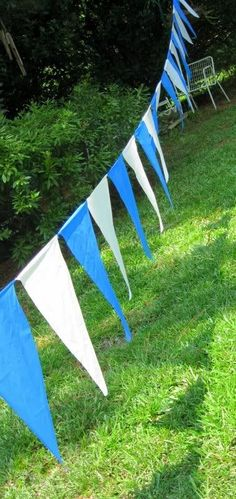 This banner was made from two $1 vinyl tablecloths, some recycled string, and a little glue. Liquid Stitch, original version, stuck well, and is waterproof. Make a Pennant Garland for Your Open House | DIY Home Staging Tips