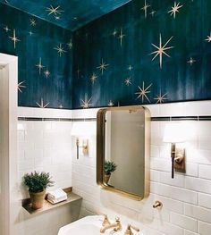 Stars painted on the ceiling for a lovely small and quirky bathroom