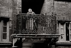 """Lady on the balcony, Spitalfields 1962. """"Her diversion for the day was standing there and watching the world go by."""""""