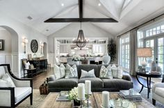 Loving the sofa with smaller sofa and wood trim