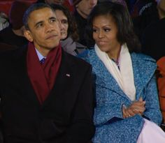 President Obama sits with first lady Michelle Obama