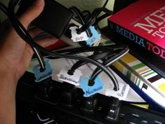 Keep your cables and power cords organized by labeling them with bread clips.