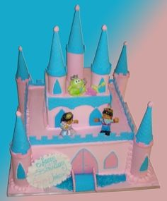 """""""Fairytale Birthday!"""" Two-Tier Castle Cake This wonderful 2-tier cake is perfect for any little girl's next big day! The both tiers are iced in a powder pink buttercream with pink and baby blue buttercream accents as a door-way and windows.  On each corner, baby blue and pink fondant create beautiful towers. Plastic figurines of a prince and princess are place on top of the first tier. On top of the second tier is a small lime green frog. This cake will be sure to bring your child's…"""