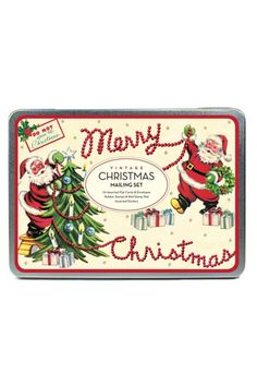 """Each set includes 24 assorted flat note cards and envelopes, along with rubber stamps and a red stamp pad. You'll love making creative Christmas note cards to send to friends and family. Made by Cavallini & Co. The set comes in a lovely metal tin, measuring 8.5"""" long by 6"""" by 1.25"""" thick.   Christmas Mailing Set by Cavallini & Co. Home & Gifts - Home Decor - Holiday Boulder, Colorado"""